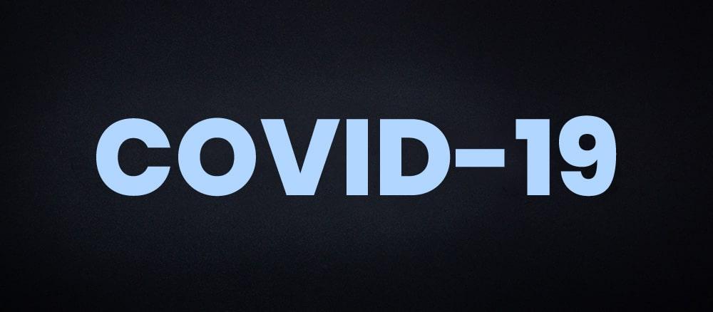 Texto Covid-19 sobre fondo oscuro